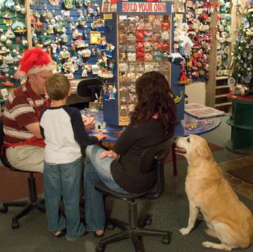 Samantha helping a family build an ornament